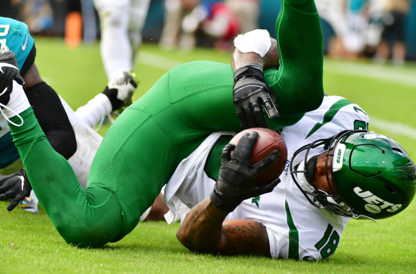 JACKSONVILLE, FLORIDA - OCTOBER 27: Demaryius Thomas #18 of the New York Jets catches a 23-yard pass thrown by Sam Darnold #14 during the fourth quarter of a football game at TIAA Bank Field on October 27, 2019 in Jacksonville, Florida. (Photo by Julio Aguilar/Getty Images)