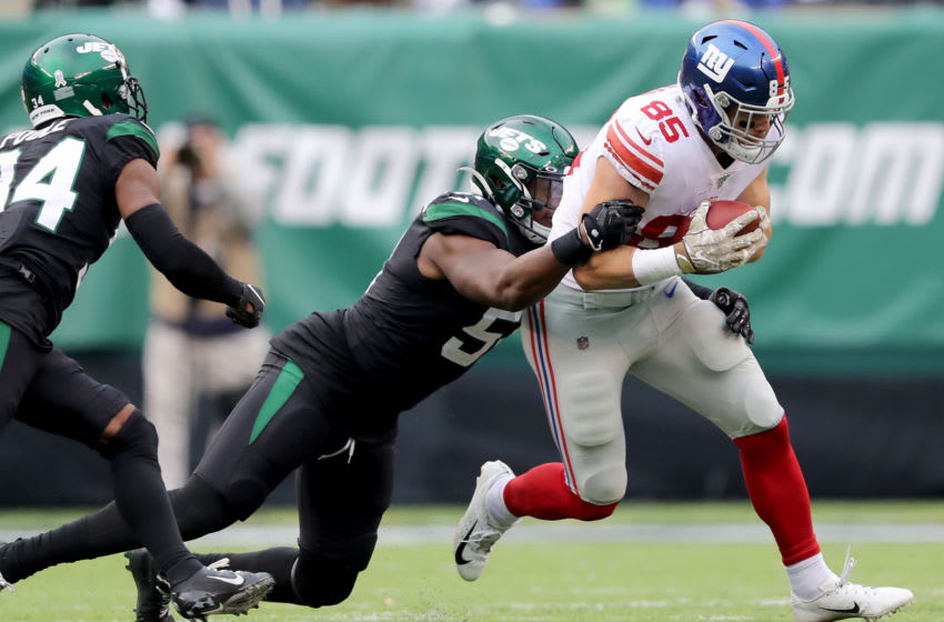 EAST RUTHERFORD, NEW JERSEY - NOVEMBER 10: Rhett Ellison #85 of the New York Giants carries the ball as Brandon Copeland #51 of the New York Jets defends at MetLife Stadium on November 10, 2019 in East Rutherford, New Jersey. (Photo by Elsa/Getty Images)