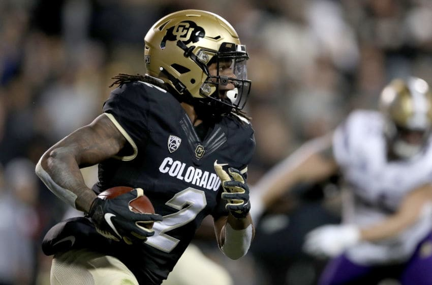 BOULDER, COLORADO - NOVEMBER 23: Laviska Shenault Jr. #2 of the Colorado Buffaloes carries the ball against the Washington Huskies in the first quarter at Folsom Field on November 23, 2019 in Boulder, Colorado. (Photo by Matthew Stockman/Getty Images)