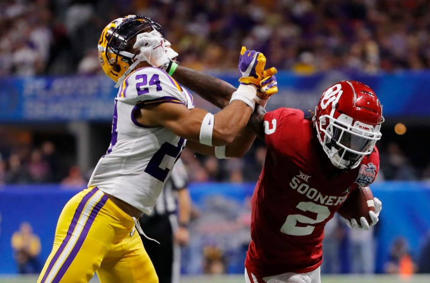 ATLANTA, GEORGIA - DECEMBER 28: Wide receiver CeeDee Lamb #2 of the Oklahoma Sooners carries the ball against Derek Stingley Jr. #24 of the LSU Tigers during the Chick-fil-A Peach Bowl at Mercedes-Benz Stadium on December 28, 2019 in Atlanta, Georgia. (Photo by Kevin C. Cox/Getty Images)