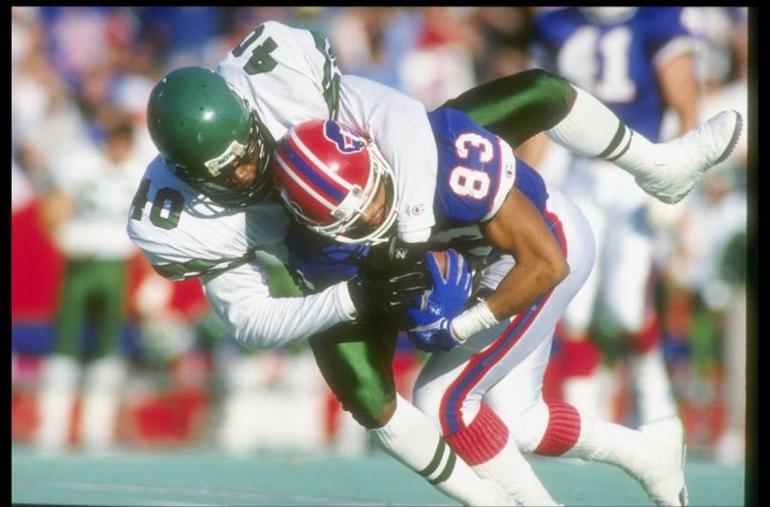 21 Oct 1990: Defensive back James Hasty of the New York Jets tackles Buffalo Bills wide receiver Andre Reed during a game at Rich Stadium in Orchard Park, New York. The Bills won the game, 30-27. Mandatory Credit: Rick Stewart /Allsport