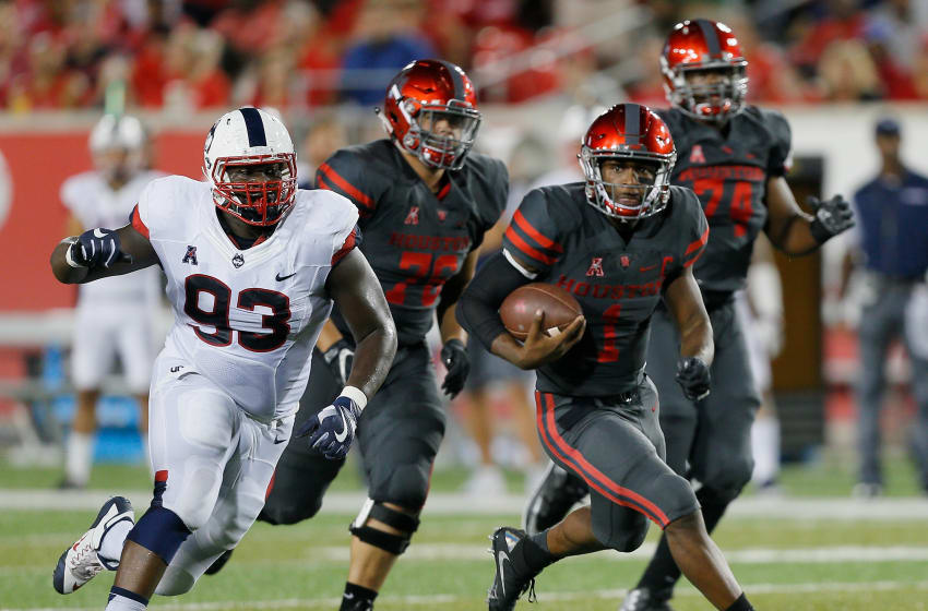 HOUSTON, TX - SEPTEMBER 29: Greg Ward Jr. #1 of the Houston Cougars rushes with the ball as Folorunso Fatukasi #93 of the Connecticut Huskies pursues in the first half on September 29, 2016 in Houston, Texas. (Photo by Bob Levey/Getty Images)