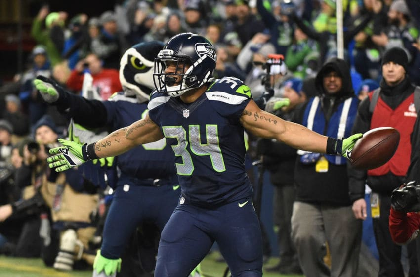 SEATTLE, WA - JANUARY 07: Thomas Rawls #34 of the Seattle Seahawks celebrates scoring a 4-yard touchdown during the fourth quarter against the Detroit Lions in the NFC Wild Card game at CenturyLink Field on January 7, 2017 in Seattle, Washington. (Photo by Steve Dykes/Getty Images)