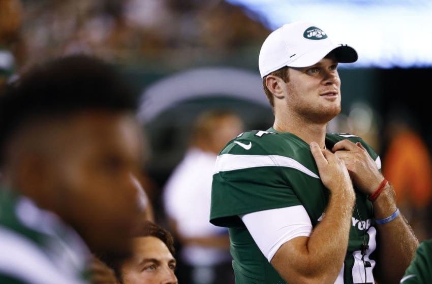 EAST RUTHERFORD, NJ - AUGUST 24: Sam Darnold #14 of the New York Jets stands at the bench during their preseason game against the New Orleans Saints at MetLife Stadium on August 24, 2019 in East Rutherford, New Jersey. (Photo by Jeff Zelevansky/Getty Images)