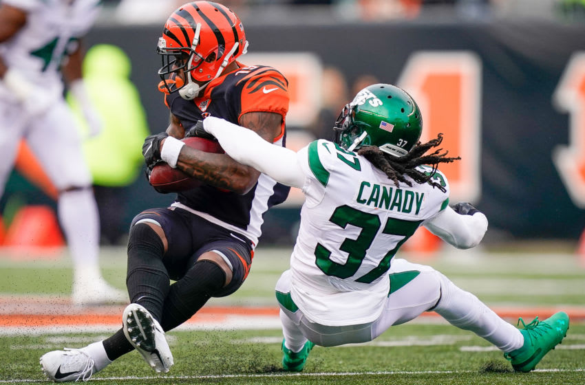 CINCINNATI, OH - DECEMBER 01: Maurice Canady #37 of the New York Jets tackles Auden Tate #19 of the Cincinnati Bengals during the second half of NFL football game at Paul Brown Stadium on December 1, 2019 in Cincinnati, Ohio. (Photo by Bryan Woolston/Getty Images)