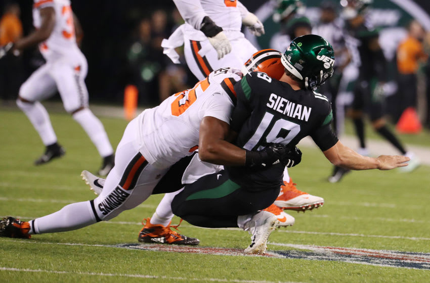 EAST RUTHERFORD, NEW JERSEY - SEPTEMBER 16: Trevor Siemian #19 of the New York Jets is hurt on this play after he is tackled after a pass by Myles Garrett #95 of the Cleveland Browns during their game at MetLife Stadium on September 16, 2019 in East Rutherford, New Jersey. (Photo by Al Bello/Getty Images)