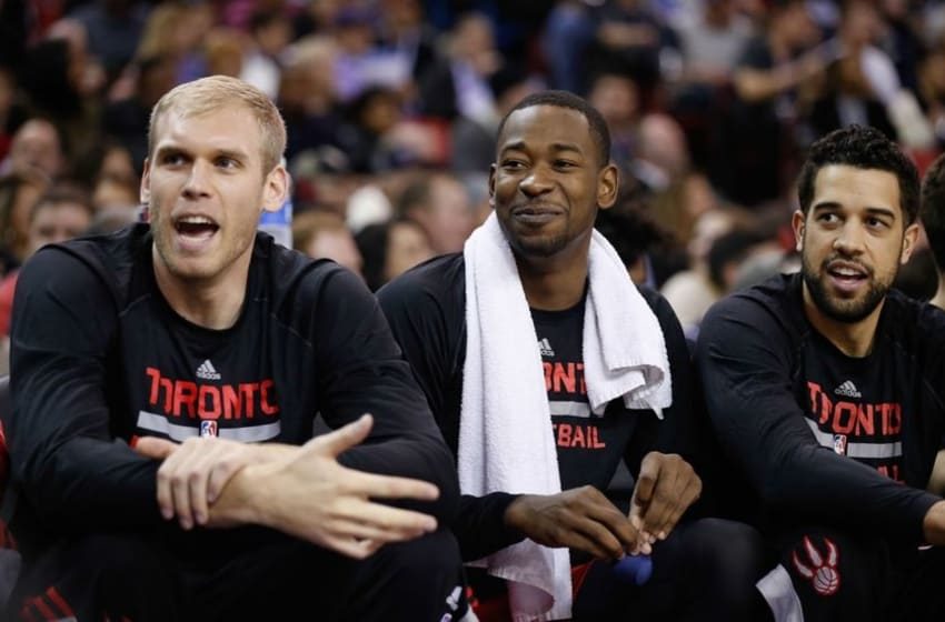 Dec 2, 2014; Sacramento, CA, USA; Toronto Raptors center Greg Stiemsma (34), forward Terrence Ross (31) and guard Landry Fields (2) engage in conversation with a court side Sacramento Kings fan during the third quarter at Sleep Train Arena. The Raptors won 117-109. Mandatory Credit: Kelley L Cox-USA TODAY Sports