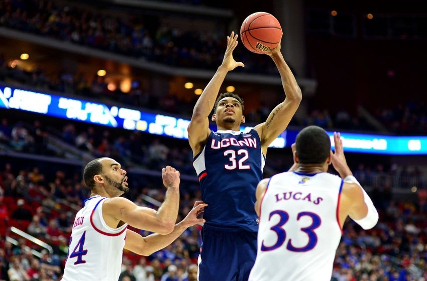 Mar 19, 2016; Des Moines, IA, USA; Connecticut Huskies forward Shonn Miller (32) shoots the ball against Kansas Jayhawks forward Perry Ellis (34) and forward Landen Lucas (33) in the second half during the second round of the 2016 NCAA Tournament at Wells Fargo Arena. Mandatory Credit: Jeffrey Becker-USA TODAY Sports