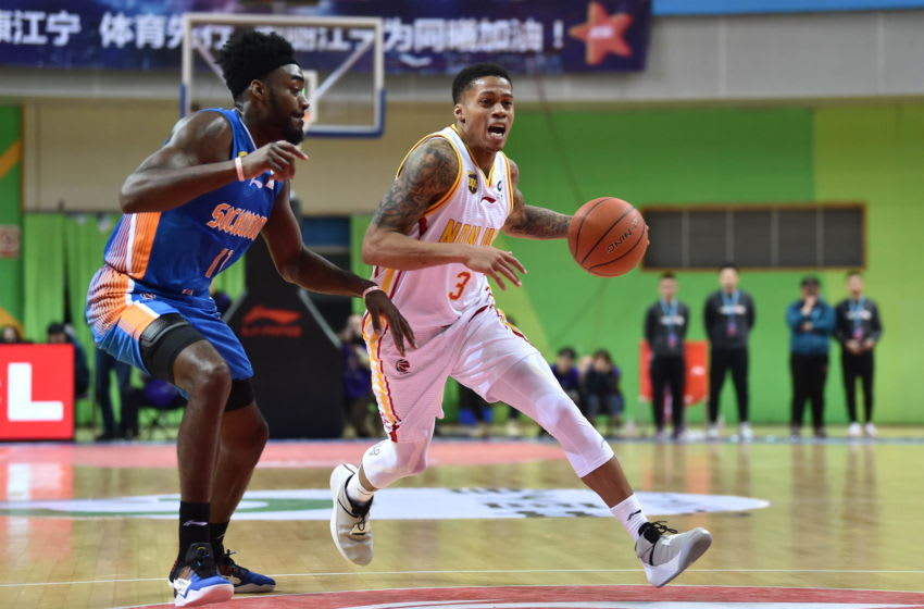 NANJING, CHINA - DECEMBER 09: Joseph Michael Young #3 of Nanjing Monkey King drives the ball against Jamaal Franklin #11 of Sichuan Blue Whales during the 2018/2019 Chinese Basketball Association (CBA) League 17th round match between Nanjing Monkey King and Sichuan Blue Whales at Jiangning Sports Center Gymnasium on December 9, 2018 in Nanjing, Jiangsu Province of China. (Photo by Visual China Group via Getty Images/Visual China Group via Getty Images)