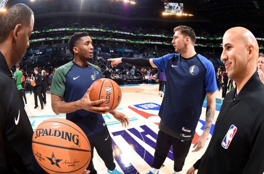 CHARLOTTE, NC - FEBRUARY 15: Donovan Mitchell #45 of the U.S. Team and Luka Doncic #77 of the World Team talk before the 2019 Mtn Dew ICE Rising Stars Game on February 15, 2019 at the Spectrum Center in Charlotte, North Carolina. NOTE TO USER: User expressly acknowledges and agrees that, by downloading and/or using this photograph, user is consenting to the terms and conditions of the Getty Images License Agreement. Mandatory Copyright Notice: Copyright 2019 NBAE (Photo by Andrew D. Bernstein/NBAE via Getty Images)