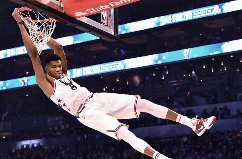 Milwaukee Bucks' Giannis Antetokounmpo swings on the rim after throwing down a two-handed dunk during the NBA All-Star Game at Spectrum Center in Charlotte, N.C. on Sunday, February 17, 2019. (Jeff Siner/Charlotte Observer/TNS via Getty Images)