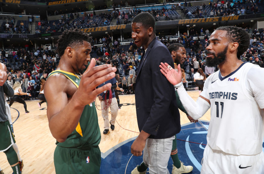 MEMPHIS, TN - MARCH 8: Donovan Mitchell #45 of the Utah Jazz congratulates Mike Conley #11 of the Memphis Grizzlies after the game on March 8, 2019 at FedExForum in Memphis, Tennessee. Copyright 2019 NBAE (Photo by Joe Murphy/NBAE via Getty Images)