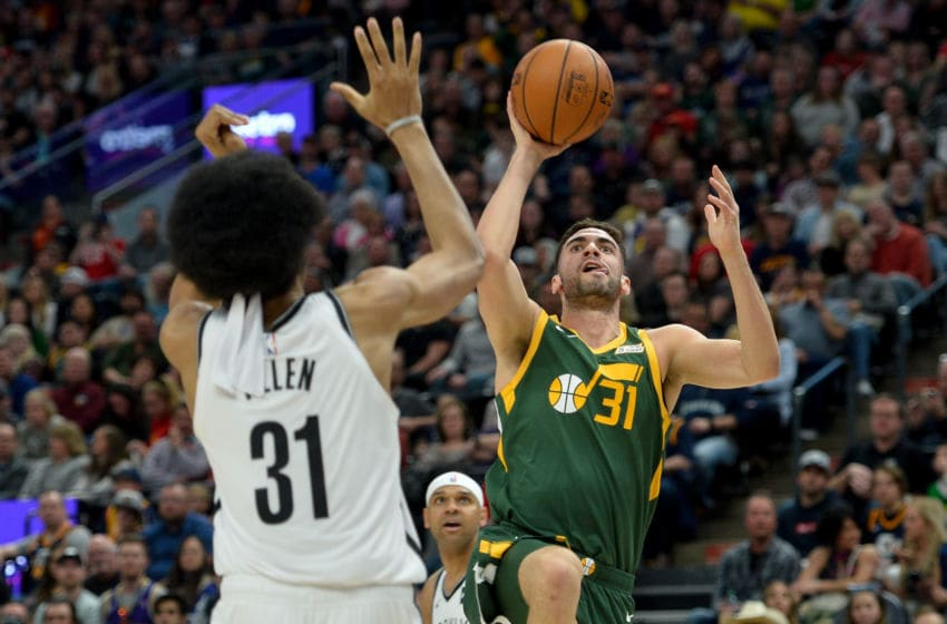 SALT LAKE CITY, UT - MARCH 16: Georges Niang #31 of the Utah Jazz shoots over Jarrett Allen #31 of the Brooklyn Nets during a game at Vivint Smart Home Arena on March 16, 2019 in Salt Lake City, Utah. NOTE TO USER: User expressly acknowledges and agrees that, by downloading and or using this photograph, User is consenting to the terms and conditions of the Getty Images License Agreement. (Photo by Alex Goodlett/Getty Images)