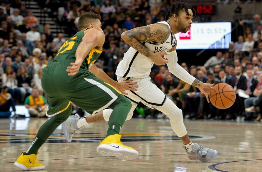 SALT LAKE CITY, UT - MARCH 16: D'Angelo Russell #1 of the Brooklyn Nets drives past Raul Neto #25 of the Utah Jazz during a game at Vivint Smart Home Arena on March 16, 2019 in Salt Lake City, Utah. NOTE TO USER: User expressly acknowledges and agrees that, by downloading and or using this photograph, User is consenting to the terms and conditions of the Getty Images License Agreement. (Photo by Alex Goodlett/Getty Images)