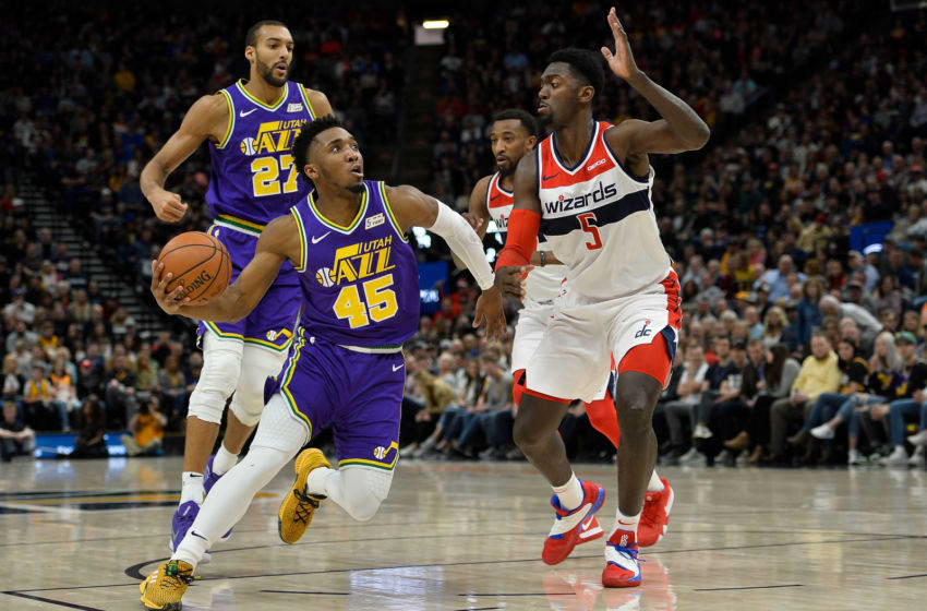 SALT LAKE CITY, UT - MARCH 29: Donovan Mitchell #45 of the Utah Jazz drives past Bobby Portis #5 of the Washington Wizards during a game at Vivint Smart Home Arena on March 29, 2019 in Salt Lake City, Utah. (Photo by Alex Goodlett/Getty Images)