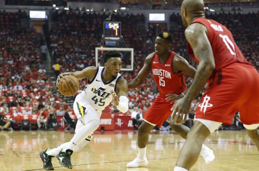 Donovan Mitchell, Utah Jazz. PJ Tucker, Clint Capela, Houston Rockets. (Photo by Tim Warner/Getty Images)