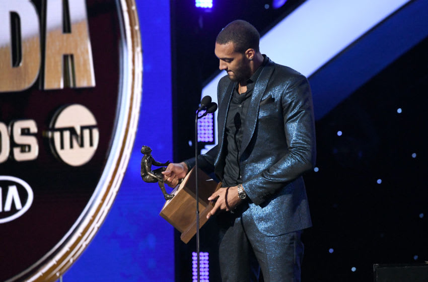 SANTA MONICA, CALIFORNIA - JUNE 24: Rudy Gobert accepts the Kia NBA Defensive Player of the Year award onstage during the 2019 NBA Awards presented by Kia on TNT at Barker Hangar on June 24, 2019 in Santa Monica, California. (Photo by Michael Kovac/Getty Images for Turner Sports)