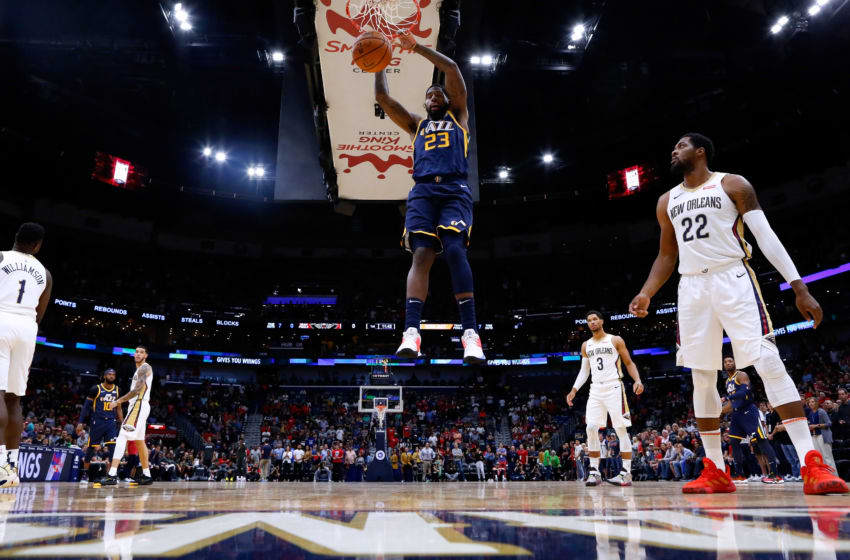 NEW ORLEANS, LOUISIANA - OCTOBER 11: Royce O'Neale #23 of the Utah Jazz dunks as Derrick Favors #22 of the New Orleans Pelicans defends during a preseason game at the Smoothie King Center on October 11, 2019 in New Orleans, Louisiana. NOTE TO USER: User expressly acknowledges and agrees that, by downloading and or using this Photograph, user is consenting to the terms and conditions of the Getty Images License Agreement. (Photo by Jonathan Bachman/Getty Images)