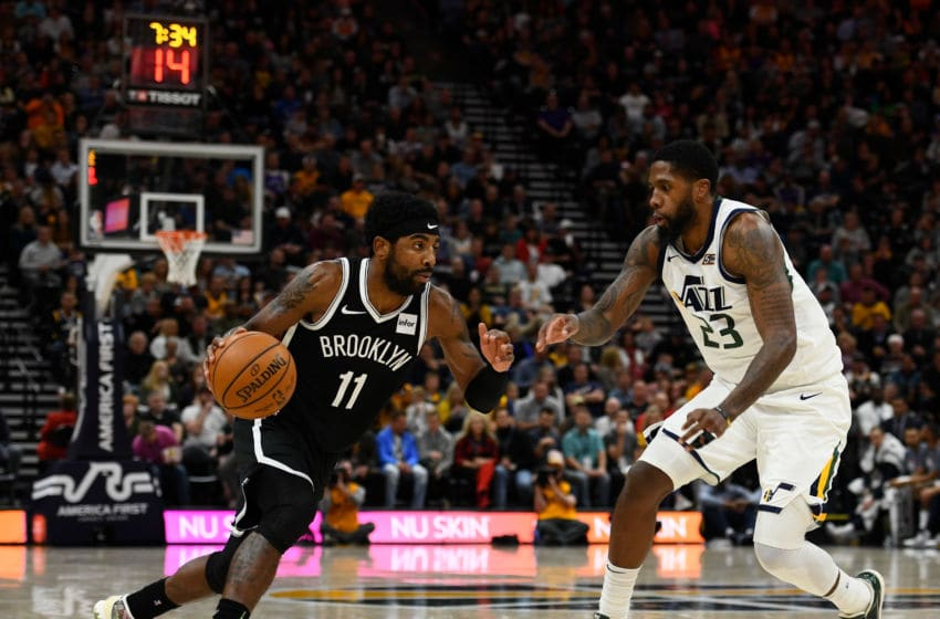 SALT LAKE CITY, UT - NOVEMBER 12: Kyrie Irving #11 of the Brooklyn Nets attempts to drive past Royce O'Neale #23 of the Utah Jazz during a game at Vivint Smart Home Arena on November 12, 2019 in Salt Lake City, Utah. NOTE TO USER: User expressly acknowledges and agrees that, by downloading and/or using this photograph, user is consenting to the terms and conditions of the Getty Images License Agreement. (Photo by Alex Goodlett/Getty Images)