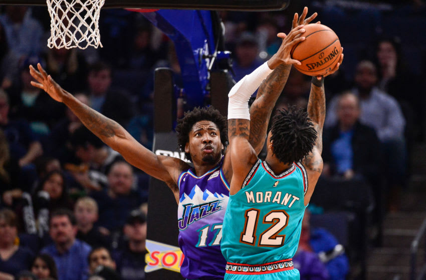 MEMPHIS, TN - NOVEMBER 29: Ed Davis #17 of the Utah Jazz defends Ja Morant #12 of the Memphis Grizzlies during the first half at FedExForum on November 29, 2019 in Memphis, Tennessee. NOTE TO USER: User expressly acknowledges and agrees that, by downloading and/or using this photograph, user is consenting to the terms and conditions of the Getty Images License Agreement. (Photo by Brandon Dill/Getty Images)