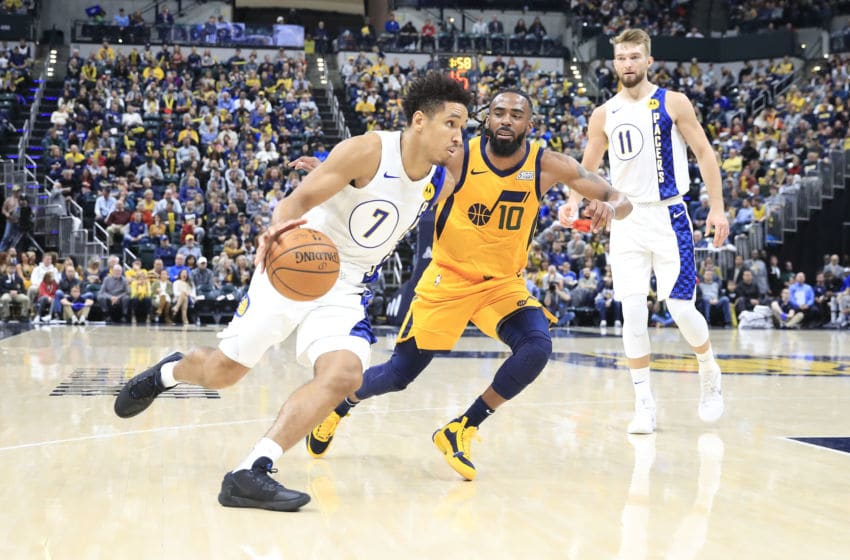 INDIANAPOLIS, INDIANA - NOVEMBER 27: Malcolm Brogdon #7 of the Indiana Pacers dribbles the ball against the Utah Jazz at Bankers Life Fieldhouse on November 27, 2019 in Indianapolis, Indiana. NOTE TO USER: User expressly acknowledges and agrees that, by downloading and or using this photograph, User is consenting to the terms and conditions of the Getty Images License Agreement. (Photo by Andy Lyons/Getty Images)