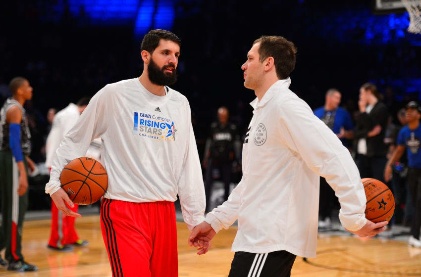 BROOKLYN, NY - FEBRUARY 13: Nikola Mirotic #14 and Bojan Bogdanovic #44 of the World Team speak prior to the BBVA Compass Rising Stars Challenge as part of 2015 All-Star Weekend on February 13, 2015 at Barclays Center in Brooklyn, New York. NOTE TO USER: User expressly acknowledges and agrees that, by downloading and/or using this photograph, user is consenting to the terms and conditions of the Getty Images License Agreement. Mandatory Copyright Notice: Copyright 2015 NBAE (Photo by David Dow/NBAE via Getty Images)