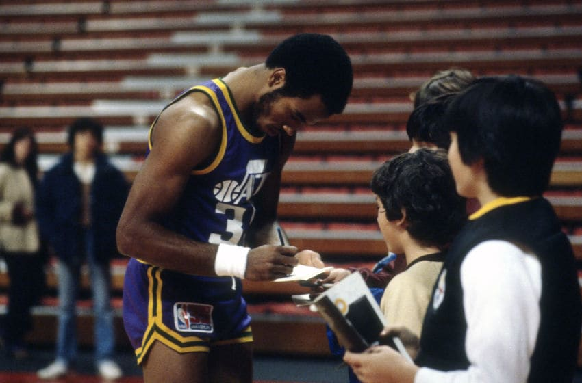 PISCATAWAY, NJ - CIRCA 1980: Darrell Griffith #35 of the Utah Jazz signs autographs for fans prior to the start of an NBA basketball game against the New Jersey Nets circa 1980 at the Rutgers Athletic Center in Piscataway, New Jersey. Griffith played for the Jazz from 1980-91. (Photo by Focus on Sport/Getty Images)