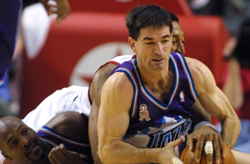 John Stockton, Bryon Russell, Utah Jazz. Scottie Pippen, Portland Trail-Blazers. (Photo credit should read JOHN GRESS/AFP via Getty Images)