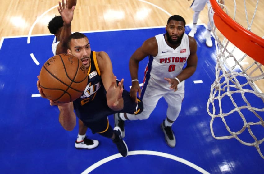 DETROIT, MI - JANUARY 24: Rudy Gobert #27 of the Utah Jazz gets to the basket past Andre Drummond #0 of the Detroit Pistons during the second half at Little Caesars Arena on January 24, 2018 in Detroit, Michigan. Utah won the game 98-95 in overtime. NOTE TO USER: User expressly acknowledges and agrees that, by downloading and or using this photograph, User is consenting to the terms and conditions of the Getty Images License Agreement. (Photo by Gregory Shamus/Getty Images)