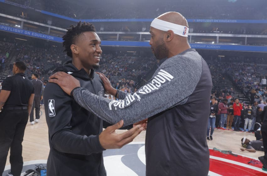 SACRAMENTO, CA - MARCH 3: Donovan Mitchell #45 of the Utah Jazz speaks with Vince Carter #15 of the Sacramento Kings prior to the game on March 3, 2018 at Golden 1 Center in Sacramento, California. NOTE TO USER: User expressly acknowledges and agrees that, by downloading and or using this photograph, User is consenting to the terms and conditions of the Getty Images Agreement. Mandatory Copyright Notice: Copyright 2018 NBAE (Photo by Rocky Widner/NBAE via Getty Images)