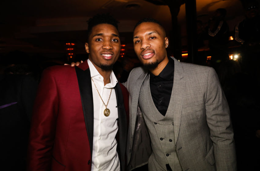 LOS ANGELES, CA - FEBRUARY 15: Donovan Mitchell (L) of the Utah Jazz poses with Damian Lillard (R) of the Portland Trailblazers at the Adidas hosts All Star Black Tie on February 15, 2018 in Los Angeles, California. (Photo by Cassy Athena/Getty Images)