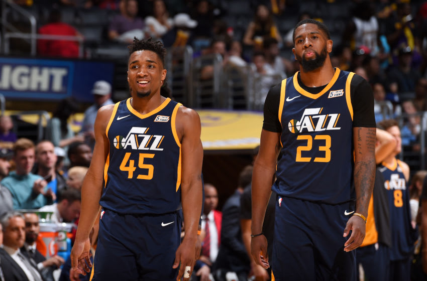 LOS ANGELES, CA - APRIL 8: Donovan Mitchell #45 of the Utah Jazz and Royce O'Neale #23 of the Utah Jazz move up the court during the game against the Los Angeles Lakers on April 8, 2018 at STAPLES Center in Los Angeles, California. NOTE TO USER: User expressly acknowledges and agrees that, by downloading and/or using this Photograph, user is consenting to the terms and conditions of the Getty Images License Agreement. Man