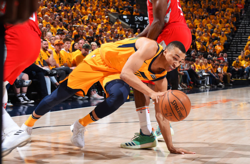 SALT LAKE CITY, UT - MAY 6: Dante Exum #11 of the Utah Jazz reaches for control of the ballagainst the Houston Rockets during Game Four of the Western Conference Semifinals of the 2018 NBA Playoffs on May 6, 2018 at the Vivint Smart Home Arena Salt Lake City, Utah. Copyright 2018 NBAE (Photo by Andrew D. Bernstein/NBAE via Getty Images)