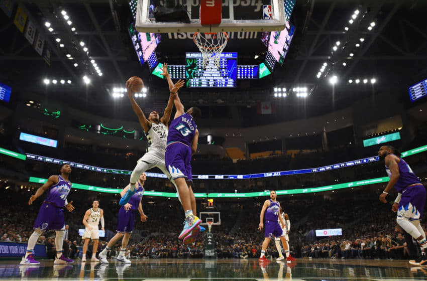MILWAUKEE, WISCONSIN - NOVEMBER 25: Giannis Antetokounmpo #34 of the Milwaukee Bucks drives to the basket against Tony Bradley #13 of the Utah Jazz during a game at Fiserv Forum on November 25, 2019 in Milwaukee, Wisconsin. NOTE TO USER: User expressly acknowledges and agrees that, by downloading and or using this photograph, User is consenting to the terms and conditions of the Getty Images License Agreement. (Photo by Stacy Revere/Getty Images)