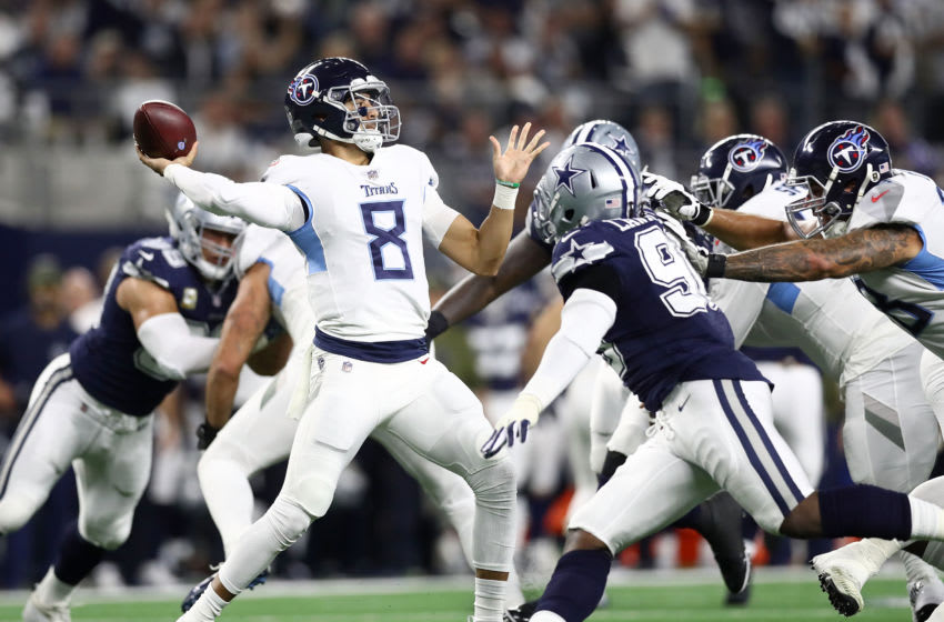 ARLINGTON, TX - NOVEMBER 05: Marcus Mariota #8 of the Tennessee Titans looks to pass agaisnt the Dallas Cowboys in the first quarter of a football game at AT&T Stadium on November 5, 2018 in Arlington, Texas. (Photo by Ronald Martinez/Getty Images)