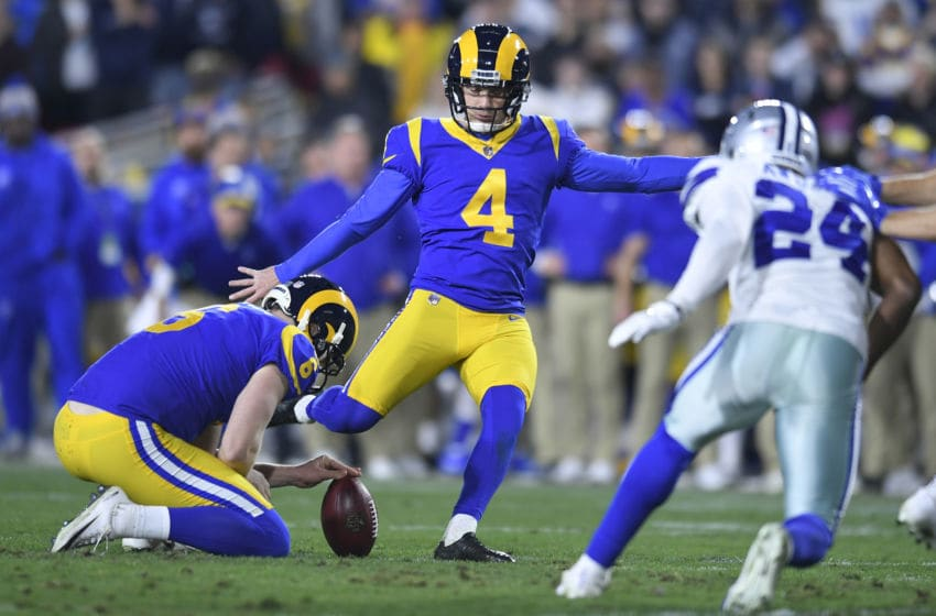 LOS ANGELES, CA - JANUARY 12: Los Angeles Rams kicker Greg Zuerlein #4 kicks a field goal aganst the Dallas Cowboys at Los Angeles Memorial Coliseum on January 12, 2019 in Los Angeles, California. (Photo by John McCoy/Getty Images)