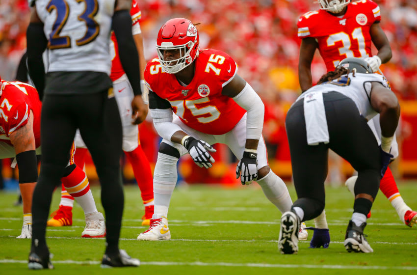 KANSAS CITY, MO - SEPTEMBER 22: Cameron Erving #75 of the Kansas City Chiefs prepares for the snap of the football against the Baltimore Ravens at Arrowhead Stadium on September 22, 2019 in Kansas City, Missouri. (Photo by David Eulitt/Getty Images)
