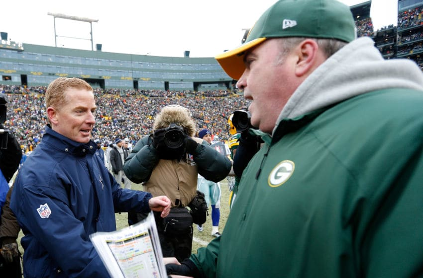 GREEN BAY, WI - JANUARY 11: Head coach Jason Garrett of the Dallas Cowboys congratulates head coach Mike McCarthy of the Green Bay Packers after the 2015 NFC Divisional Playoff game at Lambeau Field on January 11, 2015 in Green Bay, Wisconsin. The Packers defeated the Cowboys 26-21. (Photo by Joe Robbins/Getty Images)