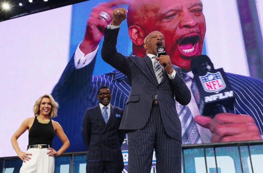 ARLINGTON, TX - APRIL 26: (L-R) Colleen Wolfe of NFL Network, Pro Football Hall of Famer and NFL Network Analyst Michael Irvin, and former NFL wide receiver Drew Pearson stand onstage during the first round of the 2018 NFL Draft at AT&T Stadium on April 26, 2018 in Arlington, Texas. (Photo by Tom Pennington/Getty Images)