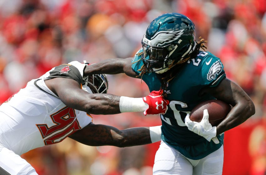 TAMPA, FL - SEPTEMBER 16: Jay Ajayi #26 of the Philadelphia Eagles stiff arms Jason Pierre-Paul #90 of the Tampa Bay Buccaneers during the first half at Raymond James Stadium on September 16, 2018 in Tampa, Florida. (Photo by Michael Reaves/Getty Images)