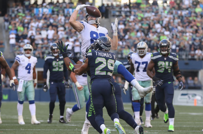 SEATTLE, WA - SEPTEMBER 23: Free safety Earl Thomas #29 of the Seattle Seahawks intercepts a pass against tight end Blake Jarwin #89 of the Dallas Cowboys in the fourth quarter at CenturyLink Field on September 23, 2018 in Seattle, Washington. (Photo by Otto Greule Jr/Getty Images)
