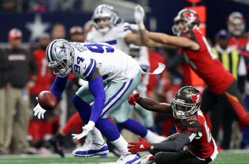 ARLINGTON, TEXAS - DECEMBER 23: Randy Gregory #94 of the Dallas Cowboys recovers a fumble against Bobo Wilson #85 of the Tampa Bay Buccaneers in the third quarter at AT&T Stadium on December 23, 2018 in Arlington, Texas. (Photo by Ronald Martinez/Getty Images)