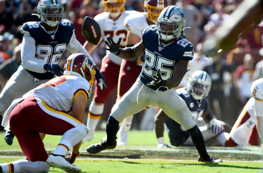 LANDOVER, MD - SEPTEMBER 15: Xavier Woods #25 of the Dallas Cowboys breaks up a pass intended for Trey Quinn #18 of the Washington Redskins during the second half at FedExField on September 15, 2019 in Landover, Maryland. (Photo by Will Newton/Getty Images)