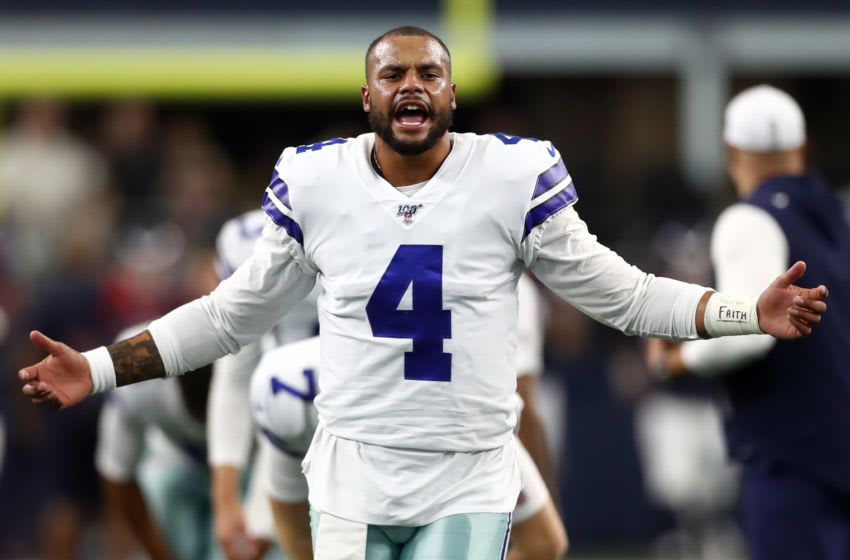 ARLINGTON, TEXAS - AUGUST 24: Dak Prescott #4 of the Dallas Cowboys stretches before a NFL preseason game against the Houston Texans at AT&T Stadium on August 24, 2019 in Arlington, Texas. (Photo by Ronald Martinez/Getty Images)