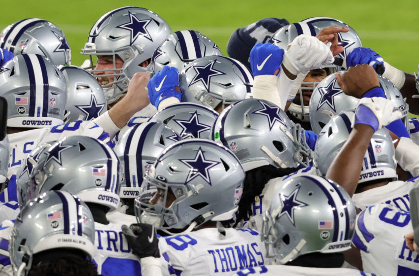 Dallas Cowboys huddle up (Photo by Rob Carr/Getty Images)
