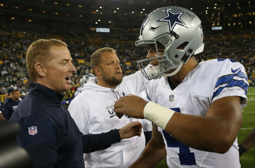 GREEN BAY, WI - OCTOBER 16: Dak Prescott #4 is congratulated by his head coach Jason Garrett of the Dallas Cowboys after defeating the Green Bay Packers at Lambeau Field on October 16, 2016 in Green Bay, Wisconsin. The Dallas Cowboys defeated the Green Bay Packers 30-16. (Photo by Dylan Buell/Getty Images)