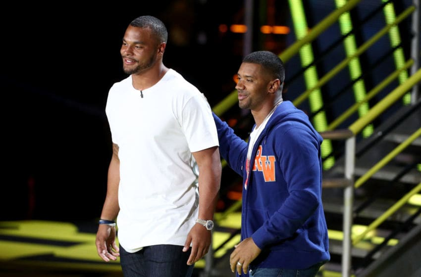 LOS ANGELES, CA - JULY 13: Host Russell Wilson (L) and NFL player Dak Prescott participate in a competition during Nickelodeon Kids' Choice Sports Awards 2017 at Pauley Pavilion on July 13, 2017 in Los Angeles, California. (Photo by Frederick M. Brown/Getty Images)