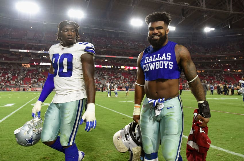 GLENDALE, AZ - SEPTEMBER 25: Running back Ezekiel Elliott #21 of the Dallas Cowboys and defensive end Demarcus Lawrence #90 walk off the field after the NFL game against the Arizona Cardinals at the University of Phoenix Stadium on September 25, 2017 in Glendale, Arizona. Dallas won 28-17. (Photo by Jennifer Stewart/Getty Images)