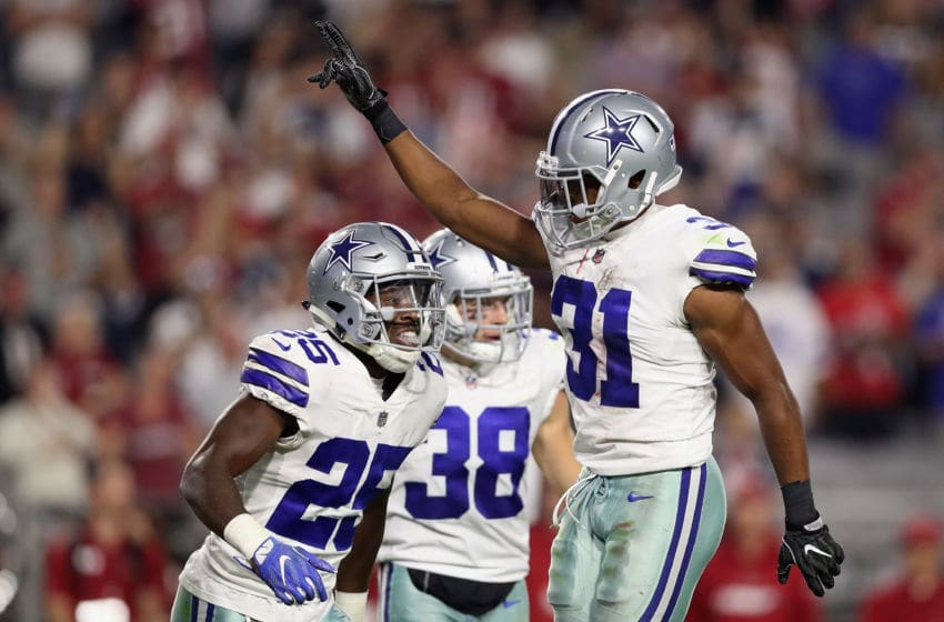 GLENDALE, AZ - SEPTEMBER 25: Free safety Byron Jones #31 of the Dallas Cowboys reacts with safety Xavier Woods #25 of the Dallas Cowboys after breaking up a fourth down pass during the NFL game against the Arizona Cardinals at the University of Phoenix Stadium on September 25, 2017 in Glendale, Arizona. The Coyboys defeated the Cardinals 28-17. (Photo by Christian Petersen/Getty Images)