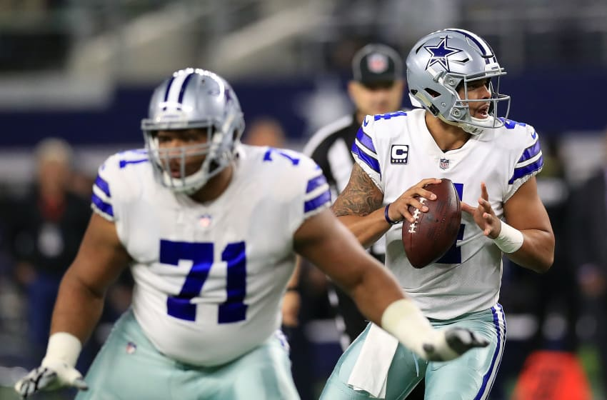 ARLINGTON, TX - NOVEMBER 19: La'el Collins #71 of the Dallas Cowboys protects Dak Prescott #4 of the Dallas Cowboys who looks to pass int he first quarter of a football game against the Philadelphia Eagles at AT&T Stadium on November 19, 2017 in Arlington, Texas. (Photo by Ronald Martinez/Getty Images)